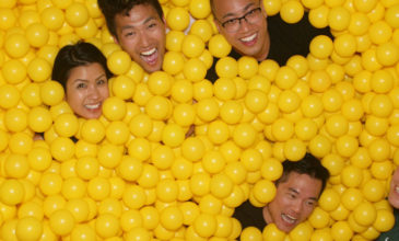 Hero employees playing in yellow ball pit