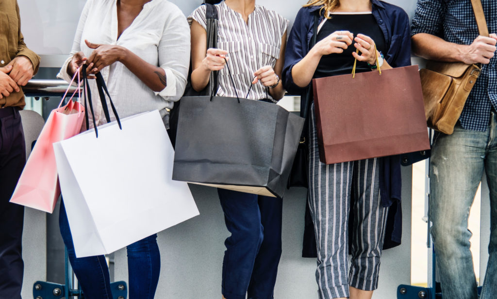 Group of people with shopping bags
