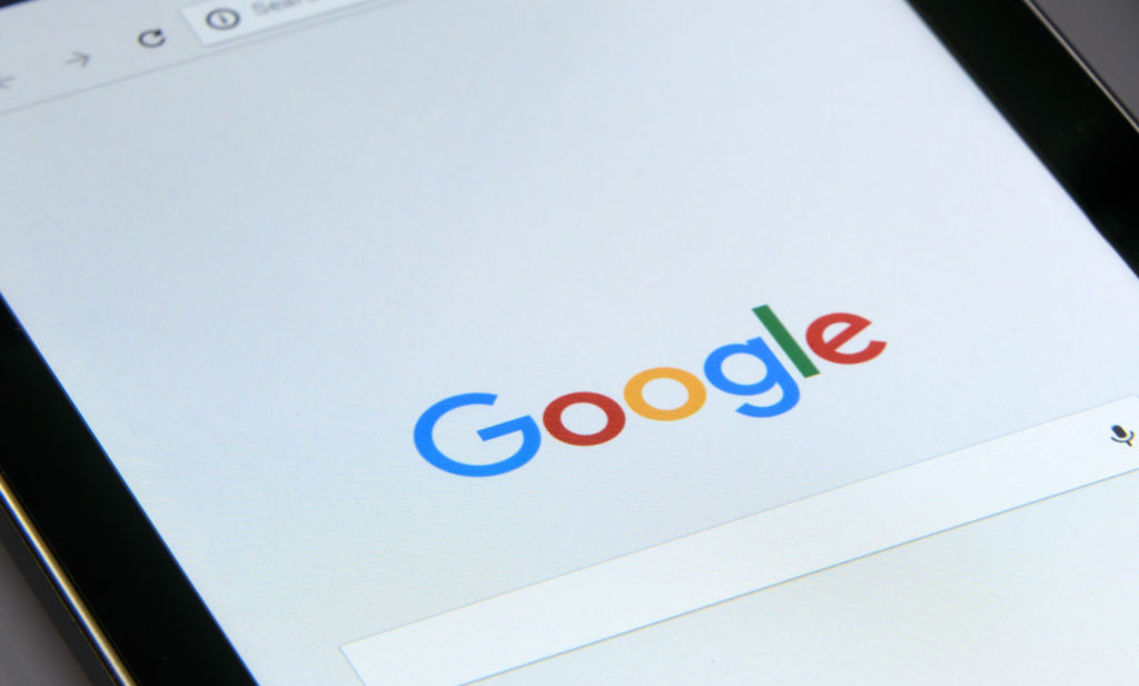iPad with Google homepage on screen