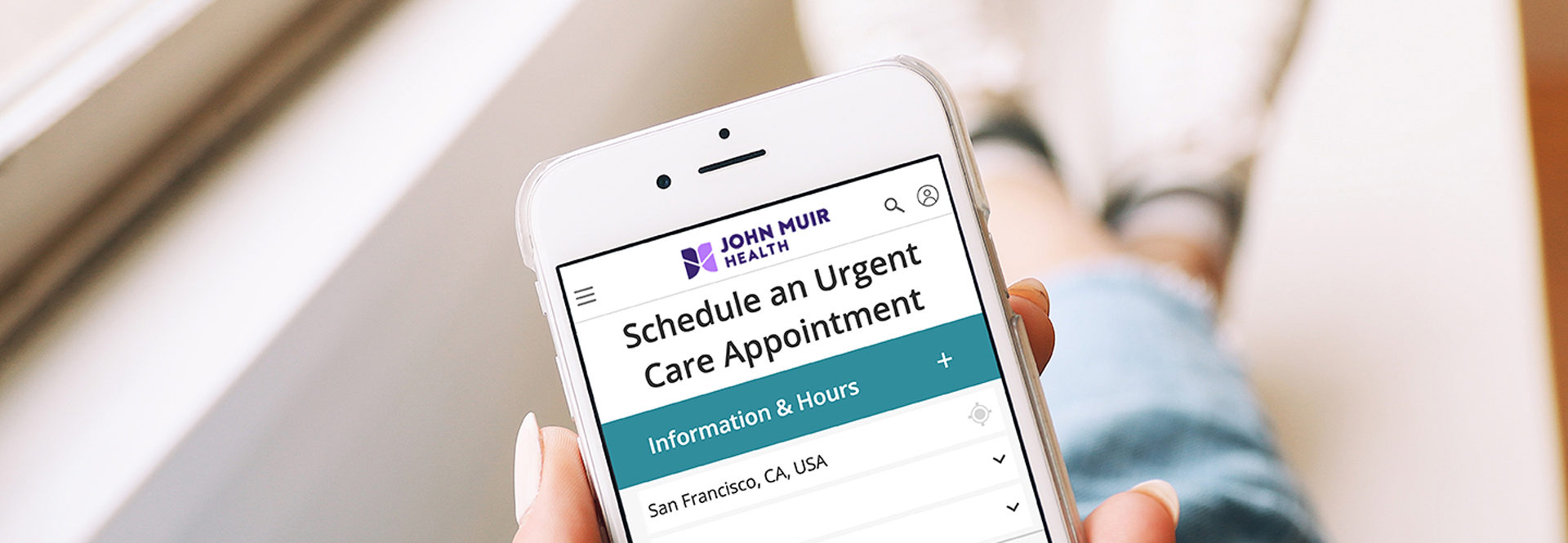 iPhone user scheduling urgent appointment on John Muir health app