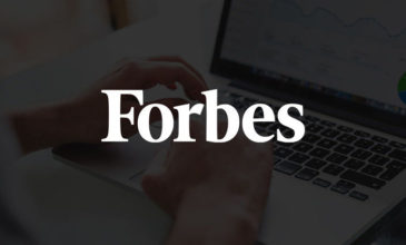 Laptop with data and Forbes logo overlay