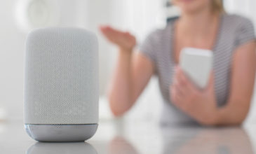 Google Home voice assistant with user in background