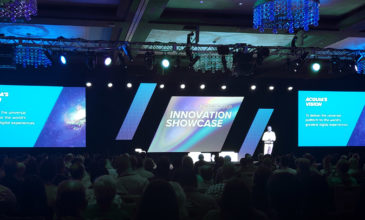 The stage during Acquia Engage Innovation Showcase with a keynote speaker in front of the crowd